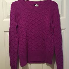 J. Crew fuchsia cable knit sweater Cable knit sweater in fuchsia. Worn only a few times. It is from Holiday 2011. No pulls on fabric great condition J. Crew Sweaters Crew & Scoop Necks