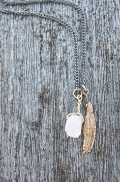 Stone and feather necklace by MLKANHNY on Etsy, $22.00