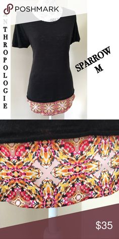 Anthropologie Sparrow layered sweater top M Black short sleeves sweater with silky bright bottom layer which peeps out like a hem. Sweater has small side slits by each hip seam. Beautiful sweater. Gorgeous. M Anthropologie Tops