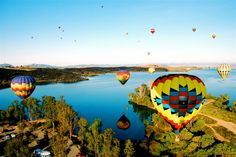 Balloons float over the Lake at the Temecula Balloon and Wine Festival Temecula, CA #ihearttemecula