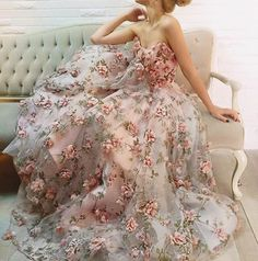 Garden-inspired gown from Teuta Matoshi Duriqi, featuring lively 3D flowers!