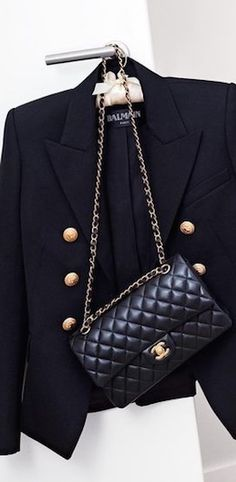 Balmain jacket and Chanel bag