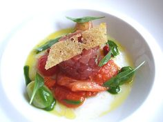 """Tartare of Pacific Big Eye Tuna, """"Croûton de Pain de Campagne,"""" Heirloom Tomatoes, Castelvetrano Olives, Sweet 100 Tomato """"Raisins"""" and Olive Leaf Sylvetta with Roquette Coulis... Oh Thomas Keller.."""