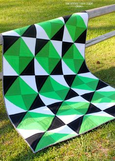 Amy Butler's Any Way You Slice It Quilt in black green and white **note how the quilt has movement when you scroll up and down**