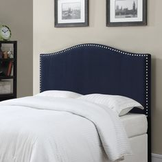 Wrapped in velvet upholstery, this nailhead-studded headboard brings a sophisticated air to your master suite or guest room. Pair it with a crisp white duvet cover for a dash of hotel-inspired elegance, or let it serve as the understated backdrop for an array of patterned pillows.
