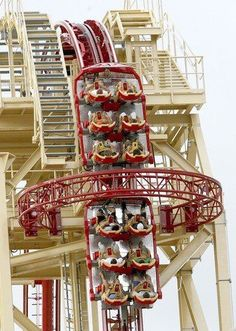 Guests in pairs travel 17 stories up ride after they board Hollywood Rip Ride Rockit roller coaster at Universal Studios Florida