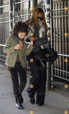 Iman Photo - Model Iman and her daughter Alexandria Zahra Jones walking in Soho on November 4 2011 in New York City