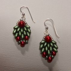 These measure 1-1/2 from the earlobe. These are so cute for the holiday season. Green super duo beads surround a 6mm red glass pearl and below 4mm red glass pearls. Two pale green/blue 8mm seed beads are used along with 11mm silver seed beads leading up to sterling silver earring wires.