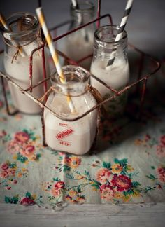 Perfect for a cookies and milk party: vintage milk  bottles and paper straws