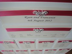 Wedding seating plan, wedding table plan with a diamante butterfly shown in hot pink