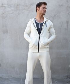 Crosby Natural Track Suit - 125 USD - A refined approach to a casual look, in a clean palate. This cream colored hoodie is soft and comfortable, and blends with any look effortlessly. These pants have the ultimate relaxed fit, a soft waistband, and contrast stitching for extra style. All of our track-suit sets look great worn together, and embody luxurious lounge wear at it's best. Paired as separates with other pieces from the collection, can give you endless options for great every day…