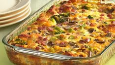 Tasty Recipe Pick: Ham and Cheese Omelet Bake. Here's a brunch bake that has it all, from ham and cheese to veggies, with a biscuit crust. Christmas Morning Breakfast, What's For Breakfast, Breakfast Dishes, Breakfast Recipes, Breakfast Casserole, Christmas Brunch, Egg Casserole, Christmas Ham, Casserole Recipes