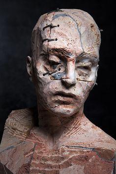 TESTA I (2013). Stone, iron and wax / Pietra, ferro e cera, cm 28 x 21 x 40.
