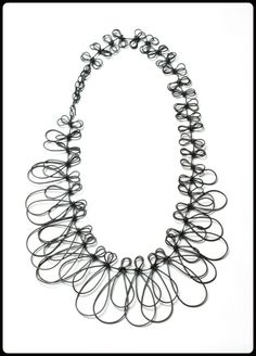 fringe necklace, by Megan Auman  I love jewelry that looks just as beautiful on a wall as it does around your neck.