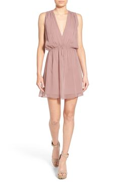 In love with this glamorous bridesmaid dress with a plunging V-neck for a romantic look.