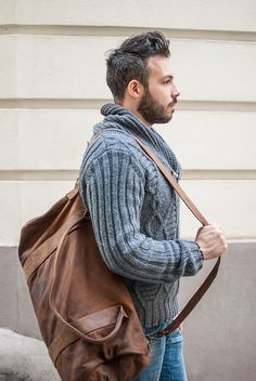 bearded man wearing a brown leather bag and knitted grey sweater - handsome guy with beard - street style