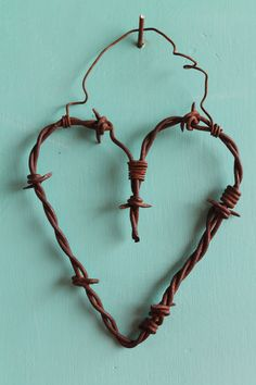 Barbed wire wall art can add a rustic touch to your home. Unconventional materials like this look good in all styles of decor. Best Picture For Wire Jewelry gemstone For Your Taste You are looking for Barb Wire Crafts, Metal Crafts, Barbed Wire Decor, Barbed Wire Wreath, Wire Wall Art, Horseshoe Crafts, Metal Garden Art, Scrap Metal Art, Heart Crafts