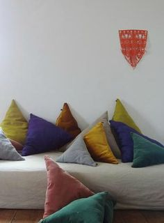 Triangular cushions from Georges http://www.georges-eshop.com/#! via Kickcan & Conkers