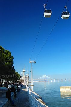 Take a ride on the cable cars over the river in das Nações, an open area in Portugal Country, Spain And Portugal, Portugal Travel, S Ki Photo, Portugal Places To Visit, Waterfront Property For Sale, Ski Holidays, Azores, Famous Places