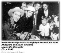 Hank & Al Rogers sign autographs for fans in Louisville ca. 1949.