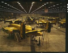 """Assembling B-25 bombers at North American Aviation. Kansas City, Kansas, October 1942. Reproduction from color slide. Photo by Alfred T. Palmer. Prints and Photographs Division, Library of Congress"" (Denver Post)"
