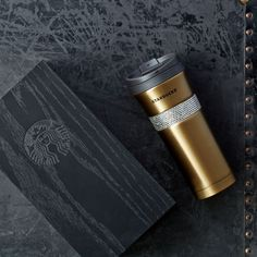 A gold stainless steel tumbler with sparkling Swarovski crystals that comes ready-to-gift in a wood box with sliding lid.