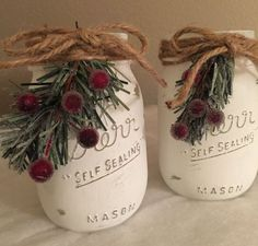 Christmas Mason jars/Rustic Christmas decorations  Set of 3 chalk painted Mason jars will make a beautiful Christmas centerpiece on your mantle or Holiday table. These painted jars also make great Christmas gifts for holiday parties! Fill with fresh cut or faux fall flowers. These pint size Mason jars are painted in white, distressed and then sealed with a clear matte finish. Each jar is topped off with a jute twine bow, snow covered greenery and frosted red berries. This set can be made as…