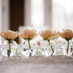 Single peach roses in tiny round vases. Maggie Conley Photography. #weddings #weddingflowers #weddingtables