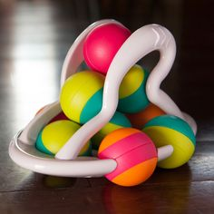 Rolligo and thousands more of the very best toys at Fat Brain Toys. Grab the ten multi-colored spheres and easily stack them inside the special Rolligo rack. Give it a little push, and - VROOOM!! - Young minds light up with delight as the vibrant colors spin in all directions!