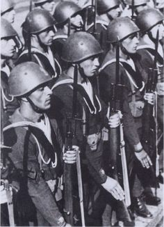 Shown here are Italian naval guards on parade at the Italian Submarine base at Bordeaux, date unknown. Taken from Hitler's U-Boat Bases.