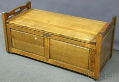 Skinner Discovery Auction   Sale 2597M Lot 743  Oak Paneled Storage Chest with Cedar Lining, including interior tray, on casters, overall ht. 22, lg. 47 1/2, wd. 21 in.  Estimate $ 150-250