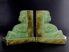 CROWN LYNN MADE IN NEW ZEALAND WHARETANA WARE NUMBER 1020 WHARETANA TIKI BOOKENDS MODELLED AS SEATED TIKI FIGURES WITH HANDS CLASPED TO ABDOMEN He... Sold for $1000.00 April 2016