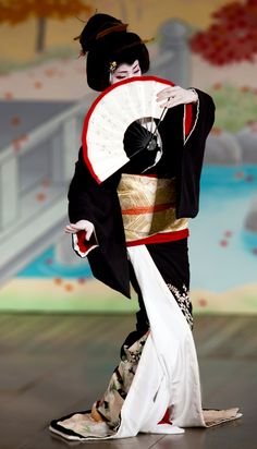 Geisha performing Traditional Japanese Dance with Fan - seen in Kyoto in spring
