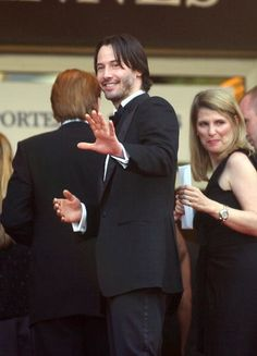 Actor Keanu Reeves waves to the crowds at the premiere of the film 'Matrix Reloaded' at the 56th International Cannes Film Festival May 15, 2003 in Cannes, France. (Photo by Frank Micelotta/Getty Images)