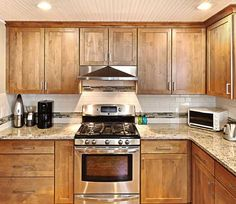 Kitchen in Traverse City, MI. Designed by Kristen Myers with Kitchen Choreography in Traverse City, MI. Fieldstone Cabinetry Buena Vista door style in Alder finished in Oregano.