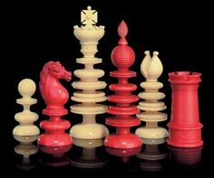 AN ENGLISH TURNED IVORY CHESS SET PROBABLY BY CALVERT, SECOND QUARTER 19TH CENTURY One side stained red, the other natural, the kings with Maltese crosses and the queens with feather finials, bishops with open mitres, knights as horses' heads and rooks as turrets The king - 3¾ in. (9.5 cm.) high; the pawn -- 1 5/8 in. (4 cm.) high GBP4375 against a pae of 12-18
