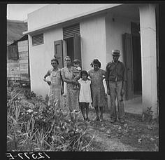 Title: A Puerto Rican family of 5.2. A resettler's family in front of their hurricane-proof house on La Plata project. Puerto Rico