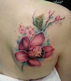 Girly Girl Orchid Tattoo Design. The color combo, the art and the placement – simply perfect!