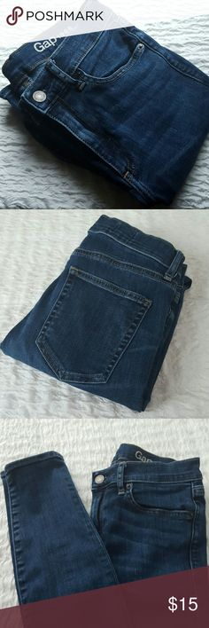 """Gap Resolution True Skinny Jeans Resolution True Skinny Jeans  In really condition overall but one pocket has a snag in the stitching, see 2nd picture, and a small scratch on one of the legs, see third picture.   Tag says 27 Regular but they run small. More like a 25.   Measurements laying flat:  Width: 13 1/2"""" Inseam: 29 GAP Jeans Skinny"""