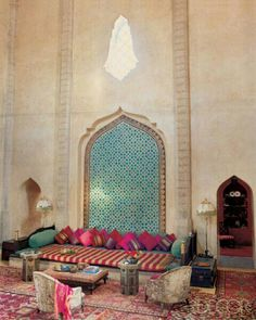 Vibrant accents anchored by sea greens and lots of different patterns, this room exemplifies the importance of finishing touches to a Moroccan scheme.