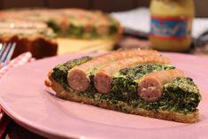 Low Carb Rezepte von Happy Carb: Deftige Spinatquiche - In der Spinatquiche kringeln sich ganz frech deftige Bratwürste.