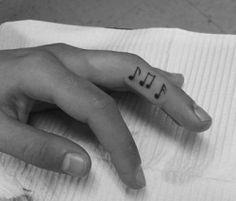 music notes on finger