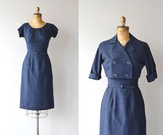 Vintage 1950s navy blue cotton-linen blend sheath dress with subtle gathered shoulders, short sleeves, fitted waist, matching belt and double breasted