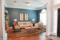 Pretty Living Room.  Love the wall color and the rug.