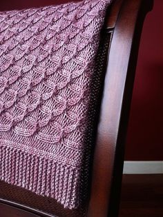 The classic cabled blanket gets a modern update with a simple, but elegant, lattice-like texture and lush garter stitch borders. To add additional charm, consider using your favorite tonal handpainted yarn. Worked flat in a worsted-weight yarn, the Sugarplums blanket comes in three useful sizes, from a modern carriage blanket to a lap throw and a full sized afghan. The blanket is also knit as one piece, making finishing a breeze. So grab your favorite cable needle and get ready to stay cozy…