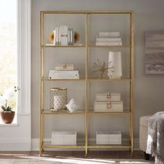 A simple frame and sleek glass shelving bring contemporary appeal with a vintage finish to the Bella Large Bookcase from Home Decorators Collection. Its extra-wide design features five shelves for books, photos, accessories and more, offering ample s Glass Bookshelves, Gold Bookshelf, Metal Bookcase, Gold Shelves, Large Bookcase, Modern Bookcase, Etagere Bookcase, Office Bookshelves, Bookcases