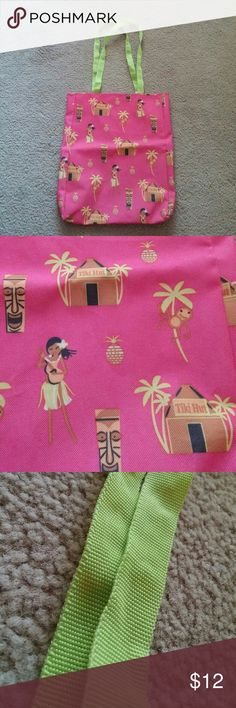 """Tiki Hut Pink Tote Bag No trades. Gently used pink tote with colorful Tiki print and green handles. There are no pockets or closures. Measures approximately 12 1/2"""" from side to side and approximately 14"""" from top to bottom. The straps measure approximately 11 1/2"""". I ship same or next day! Open to offers! Bags Totes"""