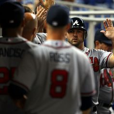 Dan Uggla #26 of the Atlanta Braves is congratulated during the game against the Miami Marlins.. welcome back uggla.. we've missed your batting average..