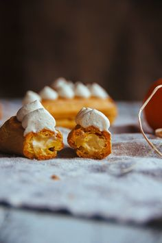 pumpkin pie eclairs; pate choux filled with a spiced pumpkin pastry cream is lightened with whipped cream to create a pumpkin pie diplomat cream that is light and airy, but still full of pumpkin flavour without being dense and stodgy; topped with a cinnamon vanilla bean whipped cream