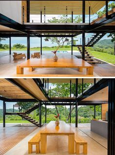 A large wooden dining table with bench seating creates a relaxed dining environment in this home. Steel Frame House, Steel House, Modern Tropical House, Tropical Houses, Steel Building Homes, Building A House, Container House Plans, Villa Design, Glass House